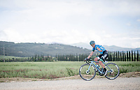 """Francesco Gavazzi (ITA/EOLO-Kometa) checking his wounded elbow while crossing the final gravel sector.<br /> <br /> 104th Giro d'Italia 2021 (2.UWT)<br /> Stage 11 from Perugia to Montalcino (162km)<br /> """"the Strade Bianche stage""""<br /> <br /> ©kramon"""