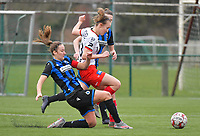 Ellen Martens (2) of Club Brugge pictured tackling Geena Lisa Buyle (13) of Zulte-Waregem during a female soccer game between SV Zulte - Waregem and Club Brugge YLA on the 13 th matchday of the 2020 - 2021 season of Belgian Scooore Womens Super League , saturday 6 th of February 2021  in Zulte , Belgium . PHOTO SPORTPIX.BE | SPP | DIRK VUYLSTEKE