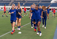 TOKYO, JAPAN - JULY 20: Emily Sonnett #14 and Crystal Dunn #2 of the USWNT warm up during a training session at the practice fields on July 20, 2021 in Tokyo, Japan.