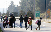 Pictured: Migrants walk on the main road Tuesday 23 February 2016<br /> Re: Migrants trying to cross the Greek-FYRO Macedonian border, were turned away by the authorities in Idomeni, Greece.