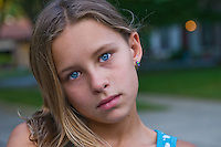 Young girl, 10-15, with blue eyes and blonde hair,