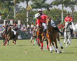 WELLINGTON, FL - MARCH 12:  Gonzalito Pieres of Audi (Red) takes control of the ball as Orchard Hill defeats Audi 9-8, in the early rounds of the 26 goal USPA Gold Cup at the International Polo Club, Palm Beach on March 12, 2017 in Wellington, Florida. (Photo by Liz Lamont/Eclipse Sportswire/Getty Images)