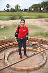 Sophary With Rainbow Checking On Construction Of New Rural School