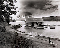 Rental boats stacked on the dock outside the Maligne Lake boathouse in Jasper National Park.