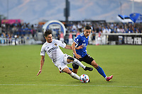 SAN JOSE, CA - JUNE 26: Jorge Villafana #19 of the LA Galaxy battles for the ball with Paul Marie #3 of the San Jose Earthquakes during a game between Los Angeles Galaxy and San Jose Earthquakes at PayPal Park on June 26, 2021 in San Jose, California.