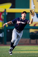 Nick Francis (3) of the Northwest Arkansas Naturals catches a fly ball hit to left field during a game against the Springfield Cardinals at Hammons Field on August 1, 2011 in Springfield, Missouri. Springfield defeated Northwest Arkansas 7-1. (David Welker / Four Seam Images)