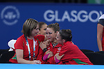 Glasgow 2014 Commonwealth Games<br /> <br /> The moment Francesca Jones realises she has won gold in the women's Individual Rhythmic Gymnastics Apparatus Final alongside her coach Jo Coombs and team mate Laura Halford.<br /> <br /> 25.07.14<br /> ©Steve Pope-SPORTINGWALES