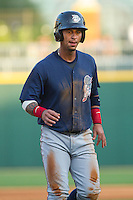 Ronny Cedeno (5) of the Lehigh Valley IronPigs jogs off the field between innings of the International League game against the Charlotte Knights at BB&T Ballpark on May 8, 2014 in Charlotte, North Carolina.  The IronPigs defeated the Knights 8-6.  (Brian Westerholt/Four Seam Images)