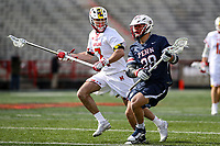 College Park, MD - February 15, 2020: Penn Quakers midfielder Matt McILwrick (28) looks to pass the ball during the game between Penn and Maryland at  Capital One Field at Maryland Stadium in College Park, MD.  (Photo by Elliott Brown/Media Images International)