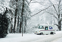 Mail delivery truck during a winter snow storm, New Jersey, USA