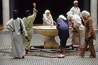 Fez, Morocco - Women Performing Ablutions at the Zawiya of Moulay Idris II.