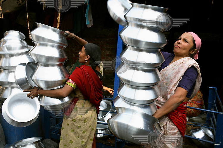 Women working in a cooking pot factory in Dhaka.