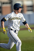 Michigan Wolverines first baseman Jimmy Kerr (15) hustles down the first base line against the San Jose State Spartans on March 27, 2019 in Game 1 of the NCAA baseball doubleheader at Ray Fisher Stadium in Ann Arbor, Michigan. Michigan defeated San Jose State 1-0. (Andrew Woolley/Four Seam Images)