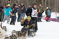 Jeremy Keller and team run past spectators on the bike/ski trail near University Lake with an Iditarider in the basket and a handler during the Anchorage, Alaska ceremonial start on Saturday, March 7 during the 2020 Iditarod race. Photo © 2020 by Ed Bennett/Bennett Images LLC
