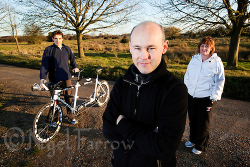 10 DEC 2011 - NORFOLK, GBR - Visually impaired Paratriathlete Iain Dawson (centre) with his guide Luke Watson (left) and his organiser and wife, Jill Dawson (right)  (PHOTO (C) NIGEL FARROW)