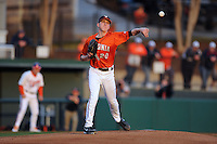 Virginia Cavaliers starting pitcher Brandon Waddell #20 attempts a pickoff during a game against the Clemson Tigers at Doug Kingsmore Stadium on March 15, 2013 in Clemson, South Carolina. The Cavaliers won 6-5.(Tony Farlow/Four Seam Images).