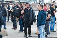 """Am Samstag den 26. April 2014 versuchte die Neonazipartei NPD in Berlin erneut einen Aufmarsch durch den Stadtteil Kreuzberg. 6.000 Menschen protestierten mit diversen Blokade dagegen und verhinderten, dass die ca 70 Neonazis weiter als 150m laufen konnten.<br /> So war nach 3 Minuten Marsch für die NPD Schluss und die Neonazis mussten zum Startpunkt am S-Bahnhof Jannowitzbruecke umdrehen. Auch wenn ueber den NPD-Lautsprecherwagen mehrfach behauptet wurde, die Demonstration sei in Kreuzberg, ist doch richtig, dass die Neonazis sich nur in Berlin-Mitte befanden.<br /> Bildmitte: Der Dortmunder Neonazifuehrer Siegfried """"SS-Siggi"""" Borchard.<br /> 26.4.2014, Berlin<br /> Copyright: Christian-Ditsch.de<br /> [Inhaltsveraendernde Manipulation des Fotos nur nach ausdruecklicher Genehmigung des Fotografen. Vereinbarungen ueber Abtretung von Persoenlichkeitsrechten/Model Release der abgebildeten Person/Personen liegen nicht vor. NO MODEL RELEASE! Don't publish without copyright Christian-Ditsch.de, Veroeffentlichung nur mit Fotografennennung, sowie gegen Honorar, MwSt. und Beleg. Konto:, I N G - D i B a, IBAN DE58500105175400192269, BIC INGDDEFFXXX, Kontakt: post@christian-ditsch.de<br /> Urhebervermerk wird gemaess Paragraph 13 UHG verlangt.]"""