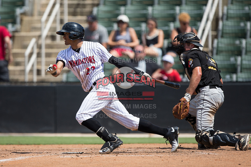 Joel Booker (23) of the Kannapolis Intimidators follows through on his swing against the West Virginia Power at Kannapolis Intimidators Stadium on June 18, 2017 in Kannapolis, North Carolina.  The Intimidators defeated the Power 5-3 to win the South Atlantic League Northern Division first half title.  It is the first trip to the playoffs for the Intimidators since 2009.  (Brian Westerholt/Four Seam Images)