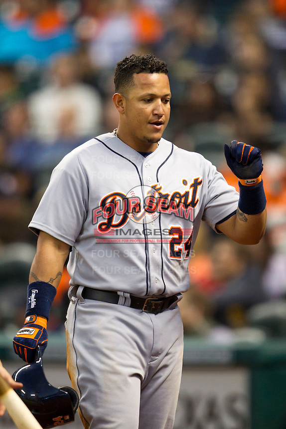 Detroit Tigers third baseman Miguel Cabrera (24) is greeted in the Tigers dugout after scoring in the fourth inning of the MLB baseball game against the Houston Astros on May 3, 2013 at Minute Maid Park in Houston, Texas. Detroit defeated Houston 4-3. (Andrew Woolley/Four Seam Images).