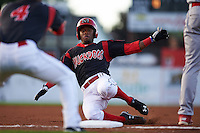 Batavia Muckdogs shortstop Anfernee Seymour (3) slides into third during a game against the Williamsport Crosscutters on August 27, 2015 at Dwyer Stadium in Batavia, New York.  Batavia defeated Williamsport 3-2.  (Mike Janes/Four Seam Images)