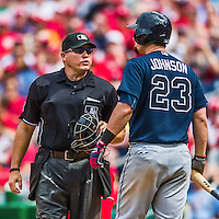 22 June 2014: MLB Umpire Mark Carlson has words with Atlanta Braves third baseman Chris Johnson, leading to Johnson's ejection in the 6th inning against the Washington Nationals at Nationals Park in Washington, DC. Johnson struck on a check swing verified by first base umpire Tim Welke, upsetting Johnson. The Nationals defeated the Braves 4-1 to split their 4-game series and take sole possession of first place in the NL East. Mandatory Credit: Ed Wolfstein Photo *** RAW (NEF) Image File Available ***