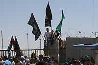 """Palestinian supporters of Hamas crowd the gate of the Palestinian side of the Rafah Crossing, in the southern Gaza Strip, on the border with Egypt during a protest demanding its reopening, Tuesday, July 10, 2007. The crossing, the main access point for Gazans to the outside world, has been closed since Hamas wrested control of the volatile Gaza Strip in fighting with the Fatah movement last month.""""photo by Fady Adwan"""""""