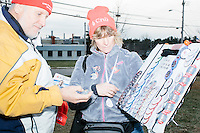 Lori Levi, of Canton, Mich., (center) sells buttons, hats, and other Cruz merchandise to Cruz supporter Gary Gahan, of Merrimack, New Hampshire, after Texas senator and Republican presidential candidate Ted Cruz speaks at a Second Amendment Rally outside Granite State Indoor Range in Hudson, New Hampshire.