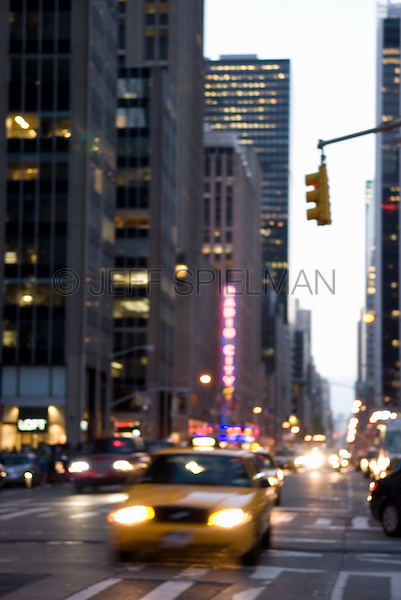 Soft Focus View of Taxi on Sixth Avenue at Dusk, Midtown Manhattan, New York City, New York State, USA