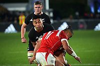 Tonga's Penikolo Latu tackles New Zealand's Rieko Ioane during the Steinlager Series rugby match between the New Zealand All Blacks and Tonga at Mt Smart Stadium in Auckland, New Zealand on Saturday, 3 July 2021. Photo: Dave Lintott / lintottphoto.co.nz