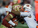 Auburn defensive end Dee Ford (30) meets face to face with FSU quarterback Jameis Winston in the first half of the BCS national title game at the Rose Bowl in Pasadena, California on January 6, 2014.