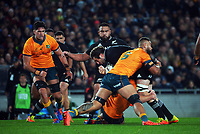 NZ captain Sam Whitelock is tackled by Lukhan Salakaia-Loto during the Bledisloe Cup rugby match between the New Zealand All Blacks and Australia Wallabies at Eden Park in Auckland, New Zealand on Saturday, 7 August 2021. Photo: Dave Lintott / lintottphoto.co.nz
