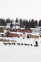 Ken Anderson runs down the river as he arrives at the White Mountain checkpoint on Tuesday afternoon during Iditarod 2008