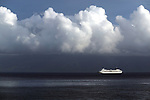 A cruise ship plys the waters off the island of Lanai, Hawaiil