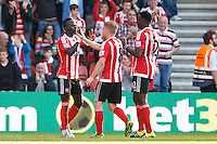 Sadio Mane celebrates scoring a goal with team mates after making it 3-0 during the Barclays Premier League match between Southampton v Swansea City played at St Mary's Stadium, Southampton