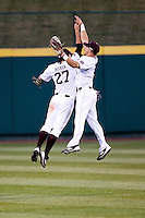 Spiker Helms (9) of the Missouri State Bears jumps in the air with Dylan Becker (27) after winning a game against the Oklahoma State Cowboys at Hammons Field on March 6, 2012 in Springfield, Missouri. (David Welker / Four Seam Images)