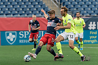 FOXBOROUGH, MA - MAY 12: Justin Rennicks #12 of New England Revolution II and Daltyn Knutson #13 of Union Omaha battle for the ball during a game between Union Omaha and New England Revolution II at Gillette Stadium on May 12, 2021 in Foxborough, Massachusetts.