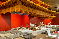 Suzhou, Jiangsu, China.  Figures Demonstrate Process of Laying the Imperial Bricks.  Suzhou Museum of Imperial Kiln Brick.