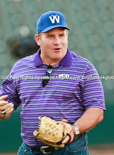 TCU head football coach, Gary Patterson, throws out the first pitch before the American Association of Independant Professional Baseball game between the Gary Southshore Railcats and the Fort Worth Cats at the historic LaGrave Baseball Field in Fort Worth, Tx. Gary Southshore defeats Fort Worth 7 to 3.