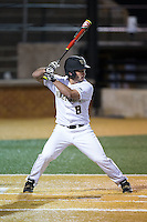 Joey Rodriguez (8) of the Wake Forest Demon Deacons at bat against the Georgetown Hoyas at David F. Couch Ballpark on February 19, 2016 in Winston-Salem, North Carolina.  The Demon Deacons defeated the Hoyas 3-1.  (Brian Westerholt/Four Seam Images)