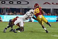 LOS ANGELES, CA - SEPTEMBER 11: Kyu Blu Kelly #17 of the Stanford Cardinal attempts to tackle Keaontay Ingram #28 of the USC Trojans during a game between University of Southern California and Stanford Football at Los Angeles Memorial Coliseum on September 11, 2021 in Los Angeles, California.