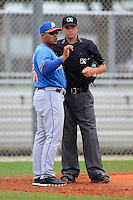 GCL Mets manager Jose Carreno (55) argues a call with umpire D.J. Jones during the first game of a double header against the GCL Cardinals on July 17, 2013 at Roger Dean Complex in Jupiter, Florida.  GCL Cardinals defeated the GCL Mets 6-5 in twelve innings.  (Mike Janes/Four Seam Images)