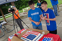 "Michael McCollum<br /> 8/2/18<br /> Ryan interacts with friends and family at the reveal ceremony where it was announced to 13 year old Ryan Overman of west Knoxville that The Wish Connection is granting Ryan's wish to go to Washington DC and visit the White House at Carl Cowan Park, 10058 S Northshore Dr, Knoxville, TN , Thursday, August 2, 2018 at 5:45pm. Approximately 50-60 people attended, including the Overman family, friends, and AT&T Employees. The Bearden High School Cadets also attended and lead the pledge of allegiance.<br />  The AT&T Wish Connection is going to send Ryan, his family, and his service dog to Washington DC and while they are gone, the group of volunteers will be doing a makeover on his bedroom and turn it into the ""Oval Office"" at the White House.<br /> Ryan was born two weeks prematurely on May 13, 2005.  During the pregnancy he was classified as high risk due to a measured lack of growth and, after a brief stay in the hospital, he came home weighing only 4 lbs 5 oz.  His development was much slower compared to his peers, such as not learning to walk until he was well over a year old, and he was much smaller. The Overman family worked with Tennessee Early Intervention Services (TEIS) when Ryan was about one year old and with their help they were able to get Ryan enrolled through TEIS to receive Occupational, Physical, and Speech Therapy.  When Ryan turned three he transitioned from TEIS to the Knox County Early Intervention Program and began attending a special school to continue his therapies until he was old enough to enroll at Cedar Bluff Elementary and now is at Cedar Bluff Middle School. In 2016, Ryan was diagnosed to have retinitis pigmentosa, a degenerative disease of the retinas that under the best of circumstances causes severe tunnel vision, but more commonly results in complete blindness.<br />  Despite the physical difficulties that Ryan has had to endure over the last thirteen years, he continually brightens the lives of those around him.  If some"