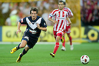 MELBOURNE, AUSTRALIA - DECEMBER 11: Robbie Kruse of the Victory chases the ball during the round 18 A-League match between the Melbourne Heart and Melbourne Victory at AAMI Park on December 11, 2010 in Melbourne, Australia. (Photo by Sydney Low / Asterisk Images)