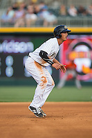 Tyler Saladino (8) of the Charlotte Knights takes his lead off of second base against the Norfolk Tides at BB&T BallPark on April 9, 2015 in Charlotte, North Carolina.  The Knights defeated the Tides 6-3.   (Brian Westerholt/Four Seam Images)