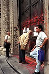 Economic Turmoil in Argentina<br /> Office workers read the notices that have been pinned to the main doors of the Bank Boston is the downtown Buenos Aires. The building has been shut, and daubed in paint. 2000s 2002