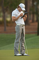 PONTE VEDRA BEACH, FL - MAY 5: Camilo Villegas makes detailed notes on the 5th green during his practice round on Tuesday, May 5, 2009 for the Players Championship, beginning on Thursday, at TPC Sawgrass in Ponte Vedra Beach, Florida.