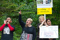 """Protesters rally outside the Washington Department of Fish and Wildlife (WDFW) headquarters in Olympia, Washington against the killing of the Profanity Peak wolf pack in eastern Washington on September 1, 2016. """"It's breaking my heart,"""" said Miguel Ramirez, from Portland, OR who says they have the same problem in their state. (photo © Karen Ducey Photography)"""