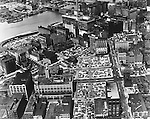 Pittsburgh PA: View of the buildings and parking lots near the Point.  Most of the buildings and lots were demolished to create Gateway Center and the new 1960s skyline.