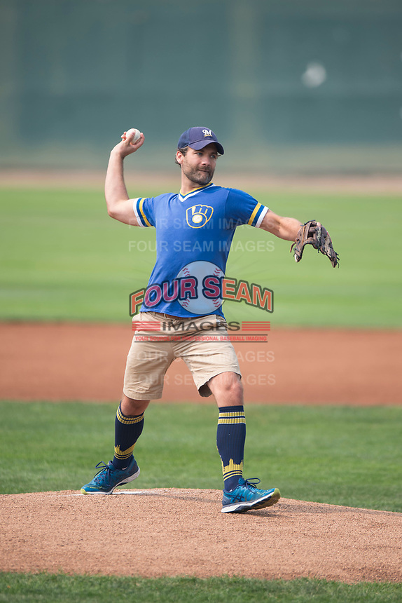 A Milwaukee Brewers fan delivers the first pitch before a Pioneer League game between the Helena Brewers and the Grand Junction Rockies at Kindrick Legion Field on August 19, 2018 in Helena, Montana. The Grand Junction Rockies defeated the Helena Brewers by a score of 6-1. (Zachary Lucy/Four Seam Images)