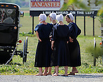 """Bare foot Amish girls talk in Pennsylvania Dutch Amish country in Lancaster County PA,Pennsylvania Dutch in Amish Country Lancaster County Pennsylvania, Amish, Horse and buggy with amish family on backroads of Pennsylvainia, buggy, amish family, buggy and horse, Commonwealth of Pennsylvania, Commonwealth of Pennsylvania, natives, Northeasterners, Middle Atlantic region, Philadelphia, Keystone State, 1802, Thirteen Colonies, Declaration of Independence, State of Independence, Liberty, Conestoga wagons, Quaker Province, Founding Fathers, 1774, Constitution written, Photography history, Fine art by Ron Bennett Photography.com, Stock Photography, Fine art Photography and Stock Photography by Ronald T. Bennett Photography ©, All rights reserved copyright Ron Bennett Photography.Com, FINE ART and STOCK PHOTOGRAPHY FOR SALE, CLICK ON  """"ADD TO CART"""" FOR PRICING,"""